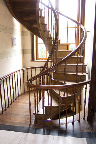 Spiral staircases outside make it easy for you to get to your swimming pool